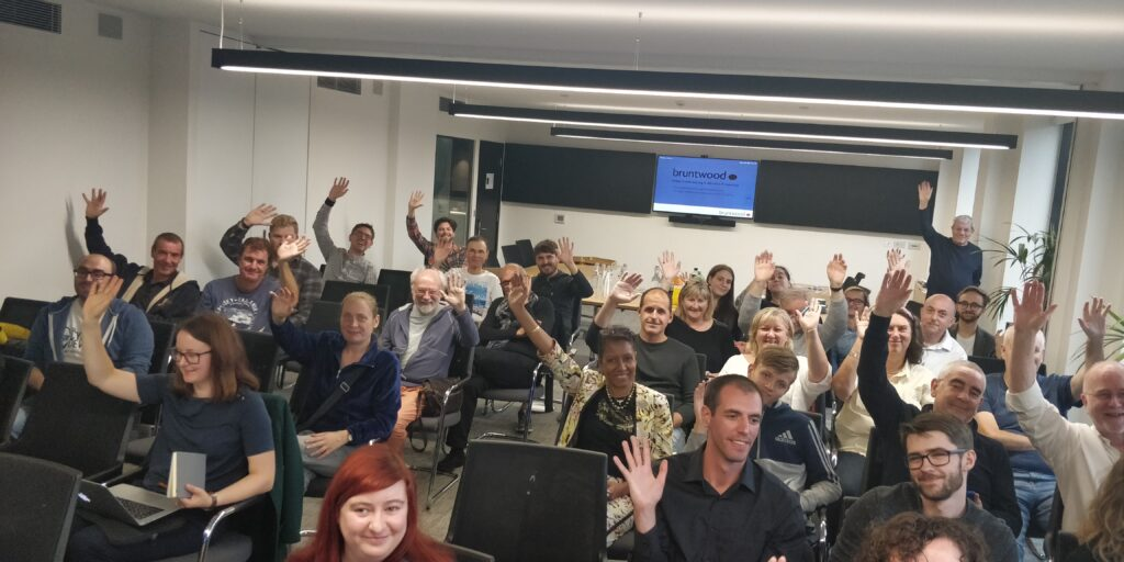 Attendees at WordPress Leeds waving